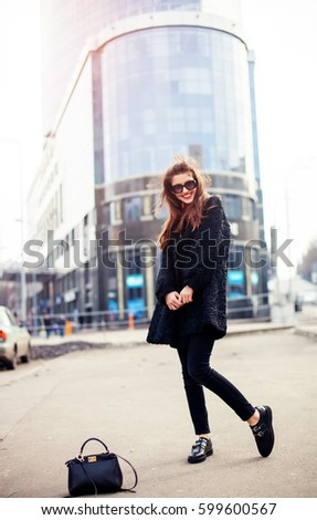 Outdoor lifestyle close up portrait of happy young woman in stylish casual outfit portrait on the street. Pretty hipster girl having fun and enjoying holidays
