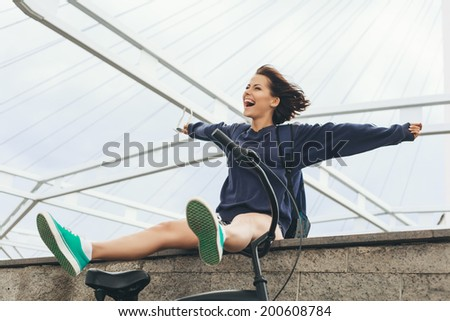 Outdoor lifestyle portrait of happy hipster teenage girl