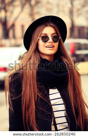 Outdoor lifestyle portrait of pretty funny hipster woman. Modern urban girl having fun. Beautiful young girl in a hat - stock photo