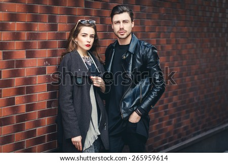 Outdoor lifestyle portrait of young couple in love standing in old town on the street