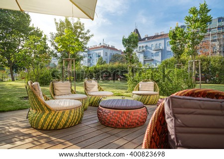 Outdoor lounge terrace with modern garden furniture - stock photo