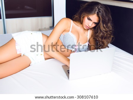 Outdoor morning portrait of smiling pretty woman working on laptop,pc computer,sensual amazing pretty face,positive emotions.Morning mood,home clothes,homework,freelancer,student writing.Toned,glowing - stock photo
