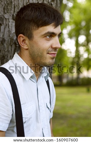 Outdoor natural portrait of a gorgeous male model - stock photo