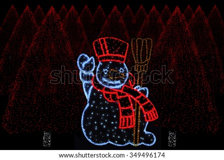 Outdoor night shot of Illuminated christmas trees and Snowman for the perfect Christmas atmosphere