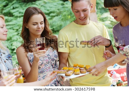 Outdoor, outside. People on the picnic - stock photo