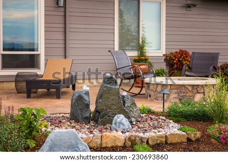 Outdoor patio behind new home - stock photo