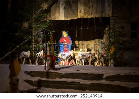 Outdoor photo at night of scene of Jesus birth in stable - stock photo