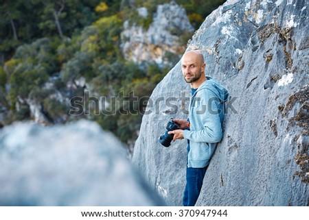 outdoor photographer on the rocks - stock photo