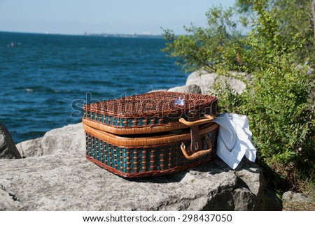 Outdoor picnic near the water. Summer Leisure. - stock photo