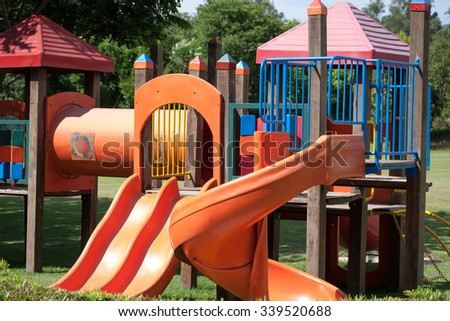 Outdoor playground for kids with slider and play house - stock photo