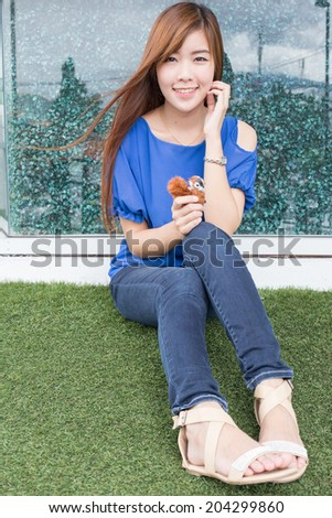 Outdoor portrait of a  beautiful asian woman. - stock photo