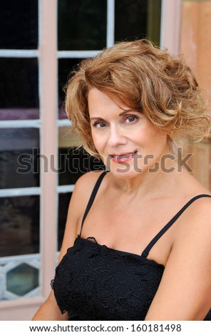 Outdoor Portrait of a Beautiful Mature Woman   - stock photo