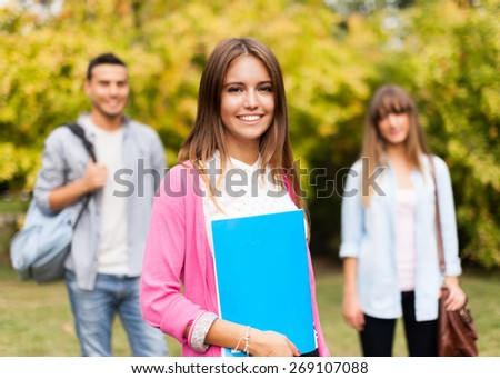 Outdoor portrait of a beautiful smiling student - stock photo