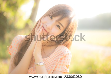 Outdoor portrait of a beautiful teenage asian girl vintage and retro tone, soft focus.