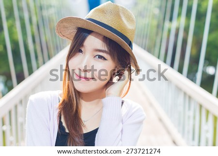 Outdoor portrait of a beautiful teenage asian girl vintage tone. - stock photo