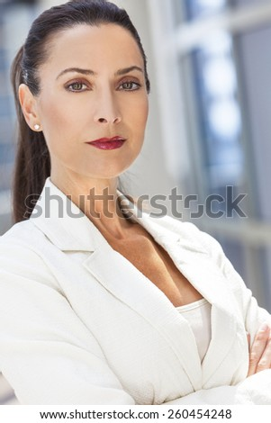 Outdoor portrait of a beautiful young brunette woman or businesswoman - stock photo