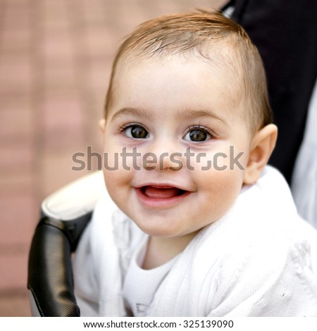 Outdoor portrait of a caucasian baby girl - stock photo