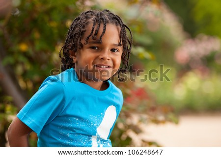 Outdoor portrait of a cute african american little boy