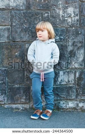 Outdoor portrait of a cute little boy - stock photo