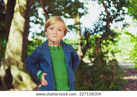 Outdoor portrait of a cute little boy of 4 years old, toned image - stock photo
