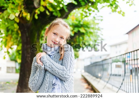 Outdoor portrait of a cute little girl - stock photo