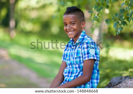 Outdoor portrait of a cute teenage black boy - African people - stock photo