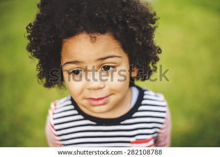 Outdoor portrait of a cute young black girl - stock photo