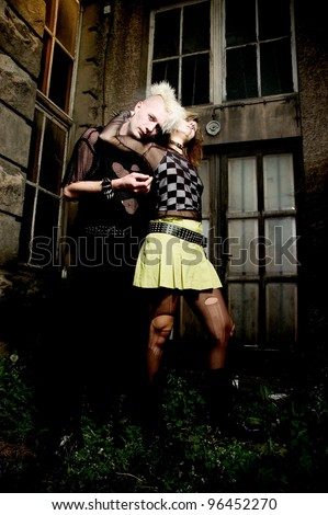 outdoor portrait of a goth punk couple - stock photo