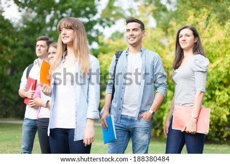 Outdoor portrait of a group of students - stock photo
