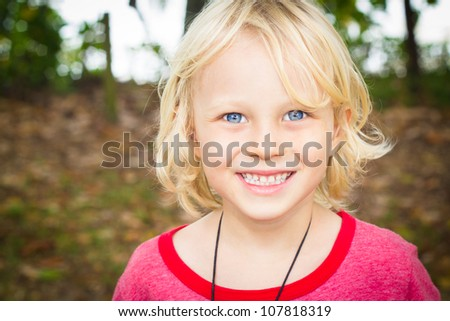 Outdoor portrait of a happy young boy