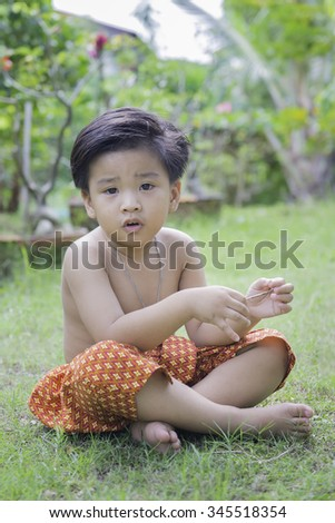 outdoor portrait of a little asian boy at the morning light.