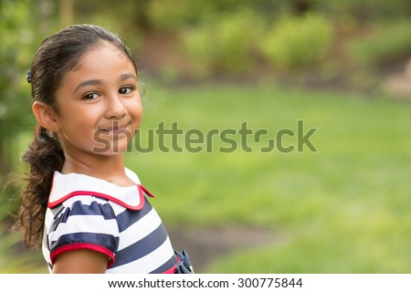 Outdoor Portrait of a Little Girl - stock photo