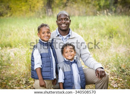 Outdoor Portrait of a Racially Diverse Father with his two sons - stock photo