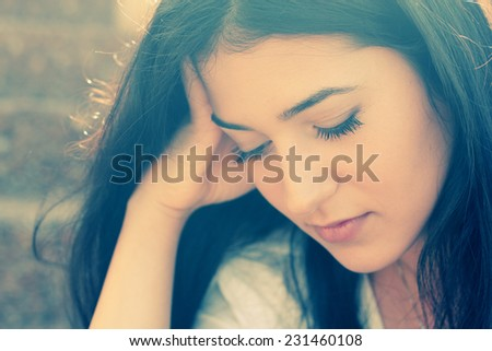 Outdoor portrait of a sad teenage girl  - stock photo