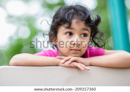 Outdoor Portrait of a Thoughtful LIttle Girl - stock photo
