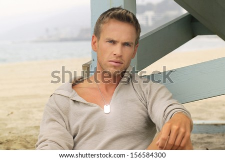 Outdoor portrait of a very handsome young man - stock photo