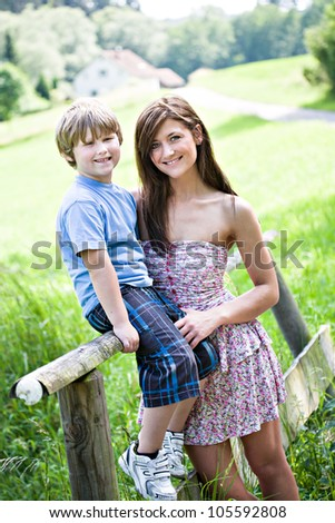 outdoor portrait of a woman and a boy - stock photo