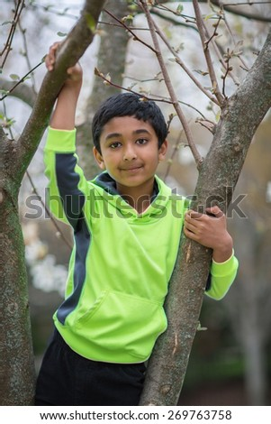 Outdoor Portrait of a Young Boy in Spring - stock photo
