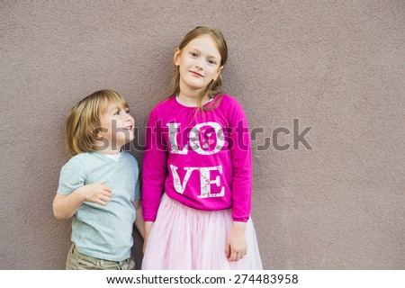 Outdoor portrait of adorable kids, little girl and boy - stock photo