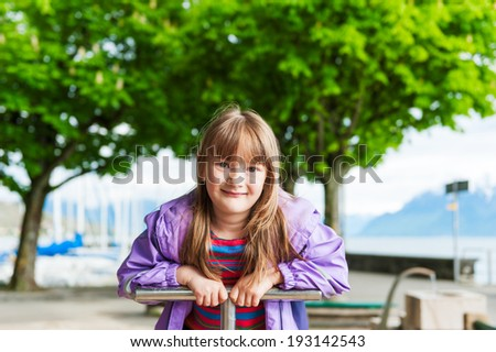 Outdoor portrait of adorable little girl in a park on a nice day