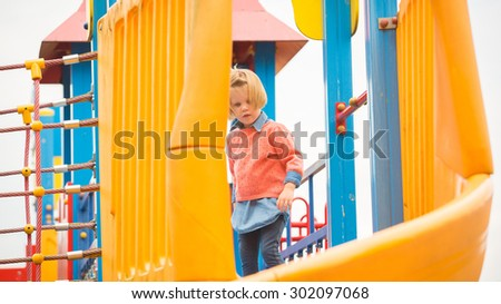 Outdoor portrait of adorable little girl playing in summer park - stock photo
