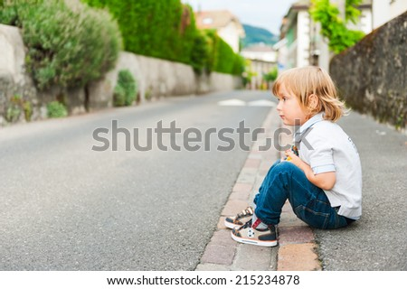 Outdoor portrait of adorable toddler boy - stock photo