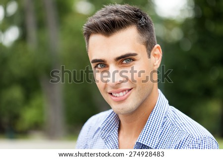 Outdoor portrait of an handsome young man