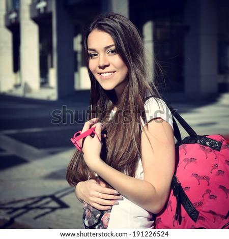 Outdoor portrait of attractive teen girl, toned. - stock photo