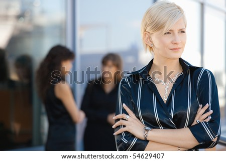 Outdoor portrait of attractive young businesswoman, smiling.