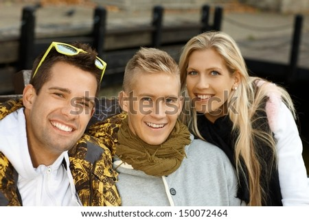 Outdoor portrait of attractive young smiling people. - stock photo