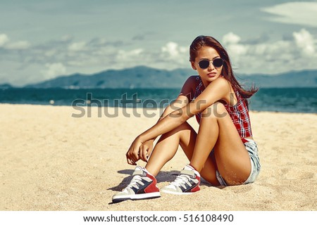 Outdoor portrait of beautiful girl on the beach