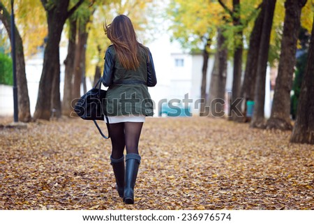 Outdoor portrait of beautiful girl walking in autumn.  - stock photo