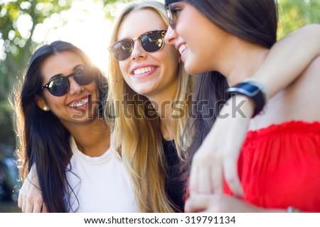 Outdoor portrait of beautiful young women having fun. - stock photo