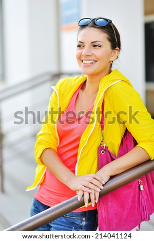 Outdoor portrait of colorful clothes gorgeous fashion girl - stock photo
